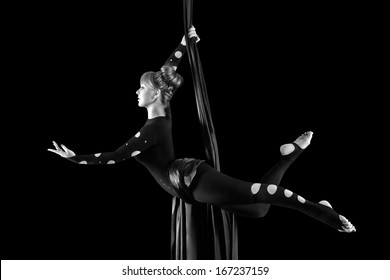 Beautiful dancer on aerial silk, aerial contortion, aerial ribbons, aerial silks, aerial tissues, fabric, ribbon, tissue