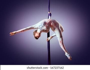 Beautiful dancer on aerial silk, aerial contortion, aerial ribbons, aerial silks, aerial tissues, fabric, ribbon, tissue