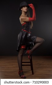 Beautiful dancer on the stage of cabaret in studio, beauty, fashion