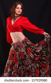 Beautiful dancer wearing red top and floral dress