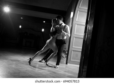 Beautiful dancers performing an argentinian tango dance. Black and white image for more effect.