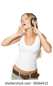 Beautiful dancing female in headphones while listening to the music over white background