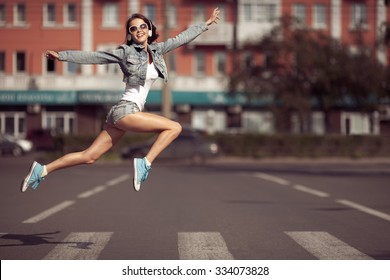 Beautiful dancing girl on a street