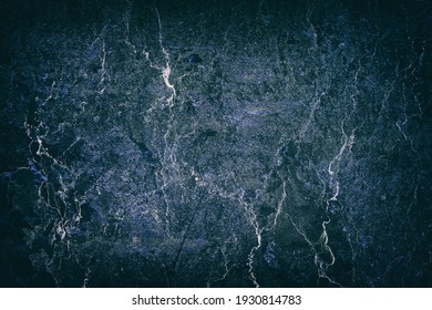 Beautiful dark blue texture of an old, cracked wall. Backgrounds. Textures.