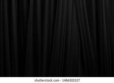 beautiful dark gray smooth cloth background vertical line, black fabric layer background, nice volume texture of textile, background of modern pattern, cloth wall with space use for element