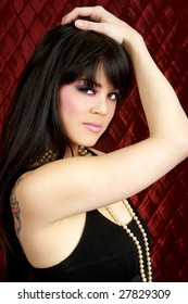 Beautiful dark haired woman in evening clothes