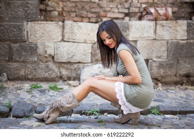 Beautiful dark haired woman looking at her legs