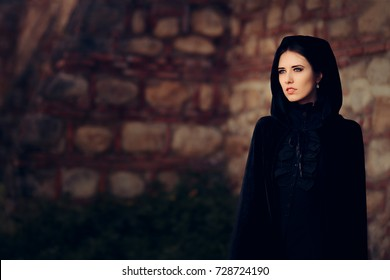 Beautiful Dark Princess in Black Hooded Cape - Magical fantasy portrait of a medieval witch