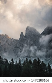 Beautiful dark rocky mountain peaks view during  a cloudy day in the italian Alps. Obscure and magic landscape concept