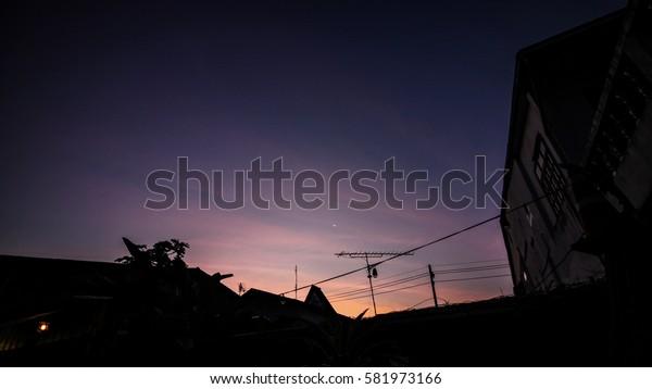 Beautiful dark sky with silhouette building