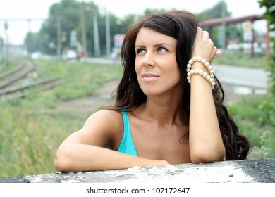 The beautiful dark-haired girl looks up