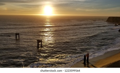 Beautiful Davenport, California sunset on the cliffs edge overlooking the beach and ocean.