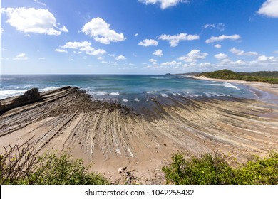 Beautiful day at the beach in Popoyo, Nicaragua, with deep color in the water and sunny weather