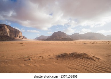 A beautiful day in the Jordanian desert of Wadi Rum. wide dessert with an amazing mountains and sand dunes , amazing scenery that you should see !
