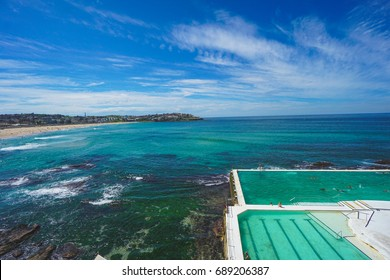 Beautiful day in Sydney Australia looking over the salt water pools, sunny sky and wispy clouds in Bondi Beach