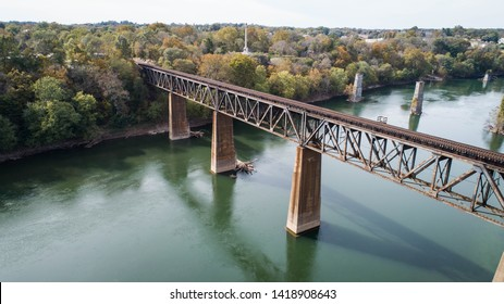 Beautiful Daytime Outdoor Aerial Drone Photography Landscape View Antique Rusted Steel Railroad Train Track Crossing Old Historic Scenic Potomac River in Maryland, USA