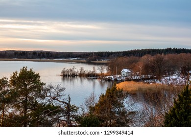 Beautiful daytime winter landscape scene against water and horizon.