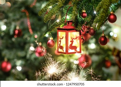 Beautiful decorated christmas tree with hanging lantern. Holiday background