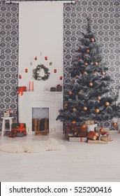 Beautiful decorated room closeup with Christmas tree with present boxes and white fireplace. Winter holiday interior design and decorations background, vertical image