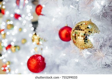 Beautiful decorated white christmas tree, Disco balls decoration for christmas dance party concept.