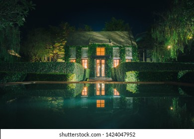 Beautiful decoration of English country style building covered with green creeper plant at night