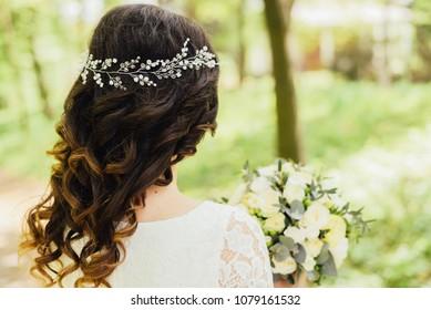 Beautiful decoration on the bride's head close-up. Wedding.