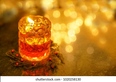 Beautiful decoration on a restaurant table. Romantic candle light with defocused light background.