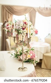 Beautiful decoration on wedding table with roses in bouquet