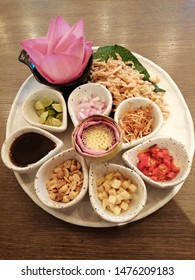 Beautiful decoration plate is Miang kham, traditional Southeast Asian snack from Thailand and Laos, consists of raw fresh pink lotus leaves to fill with roasted coconut shaving and other ingredients