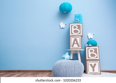 Beautiful decorations for baby shower party near color wall