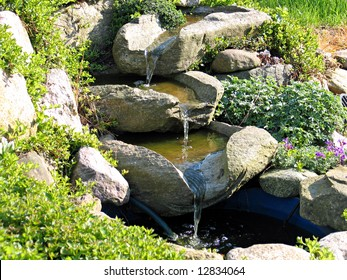 Beautiful decorative home garden stone waterfall pond