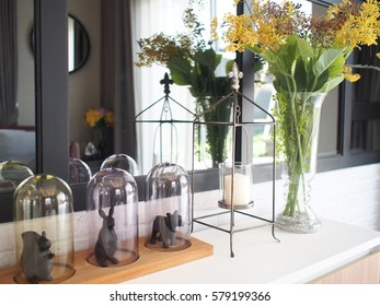 Beautiful decorative props and yellow flowers vase in livingroom.decorative item candle on console cabinet