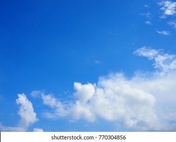 Beautiful deep blue sky with white puffy clouds on a sunny day