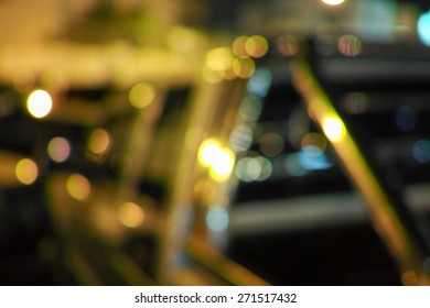 Beautiful defocused city night filtered bokeh abstract with car background.