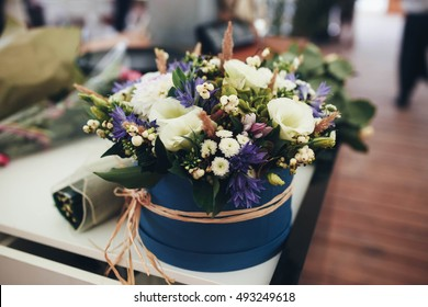 beautiful and delicate bouquet of flowers in blue round box