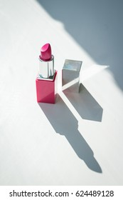Beautiful delicate concept of female life beauty. Cosmetics product. Beuty concept. Open Pink lipstick. Vertical photo