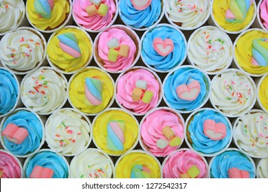 Beautiful delicious Cupcakes background. Top view.