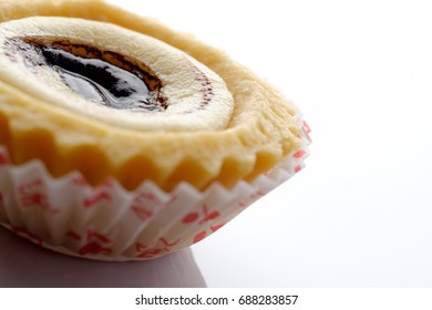 Beautiful and delicious egg tart with chocolate on top.