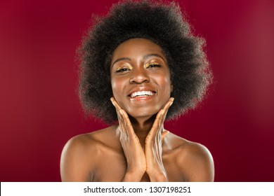 So beautiful. Delighted nice woman smiling while standing against red background