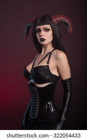 Beautiful demon girl wearing black corset and gloves, Halloween theme