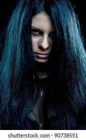 Beautiful depressive goth woman close up on black