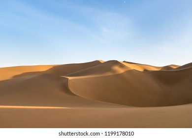 beautiful desert and blue sky, graceful lines and dramatic shadows