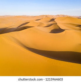 beautiful desert landscape at dusk, golden sand dunes background