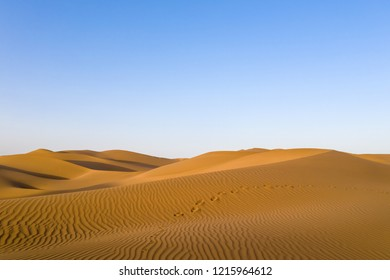 beautiful desert in sunset,footprint on golden sand dunes