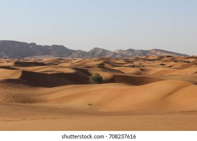Beautiful desert in United Arab Emirates with mountains in the background