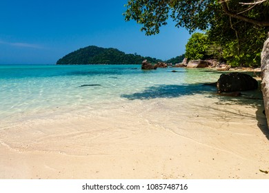 Beautiful deserted tropical sandy beach surrounded by lush jungle (Surin Islands, Thailand)