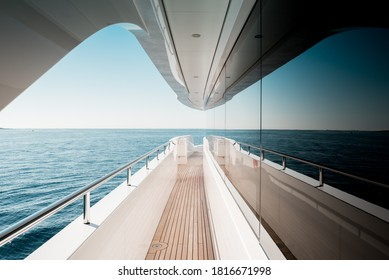 Beautiful detail of a superyacht upper deck corridor reflection on the glass windows, featuring the yacht's architectural design