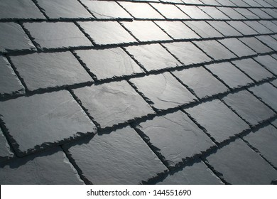 beautiful detailed slate roof close up with sun glare