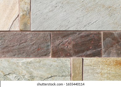 a beautiful detailed tan brown rust block cut slate rock wall close-up