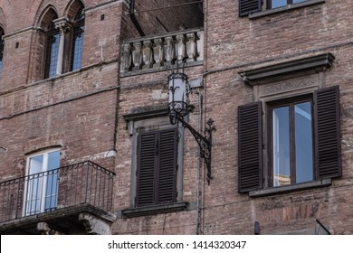 Beautiful details of ancient building in Campo square (Piazza del Campo), Siena. Italy
